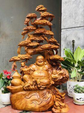 tượng gỗ di lặc ngồi gốc tùng gỗ hương ta
